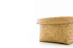 Basket made from bamboo on a white background. Royalty Free Stock Photo
