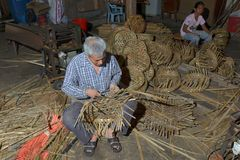 Basket maker. Basket weaving is the process of weaving or sewing pliable materials into two- or three dimensional artefacts, such as mats or containers royalty free stock photography