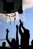 Basket match. Silhouette of a team playing basket Stock Photography