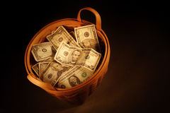 Basket of money. A basket full of money Royalty Free Stock Photography