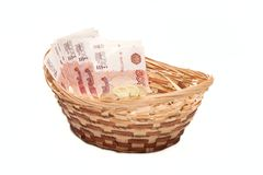 Basket with money in it Stock Photography