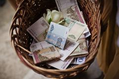 Basket of money Stock Photography