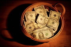 Basket of money Royalty Free Stock Photos