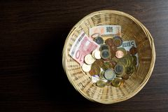 Basket of money Royalty Free Stock Images
