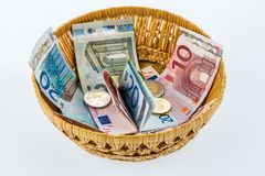 Basket with money from donations Royalty Free Stock Photos