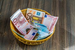 Basket with money from donations Royalty Free Stock Photo
