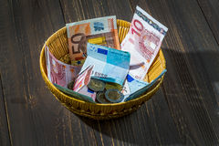 Basket with money from donations Stock Photos