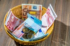 Basket with money from donations Royalty Free Stock Image