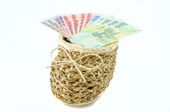 Basket with money on isolated background Stock Photography