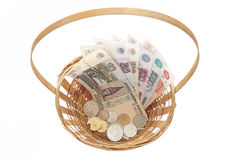 Basket of money. Russian banknotes and coins on a white background Royalty Free Stock Photography