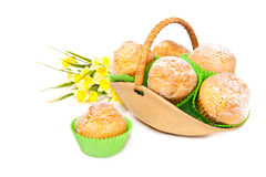 Basket of muffins decorated with spring flowers Royalty Free Stock Photo