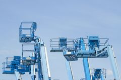 Basket of multiple forklifts are old of blue on blue sky backgro. Und Stock Photo