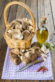 Basket with mushrooms and ingredients for cooking Stock Photo