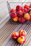 Basket of nectarines Royalty Free Stock Photography