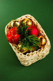 Basket with New Year's decorations. And Christmas-tree balls Stock Photo
