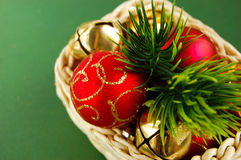 Basket with New Year's decorations. And Christmas-tree balls Royalty Free Stock Photo