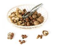 Basket with nut mix. On white background royalty free stock photo