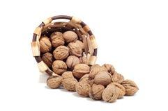 Basket of nuts, autumn fruits,  on white Royalty Free Stock Image