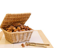 Basket of nuts and nut crackers Stock Photos