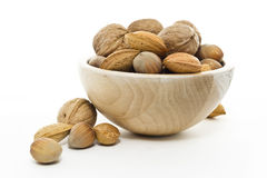 Basket nuts  in white background Stock Photo