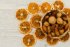 Basket of nuts on a wooden surface. Dry orange royalty free stock photo