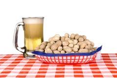 Basket Of Peanuts And Mug Of Beer Stock Photos