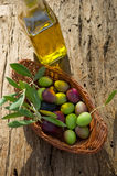 Basket with olive branch Royalty Free Stock Photos