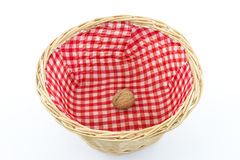 Basket with one single walnut Royalty Free Stock Photos