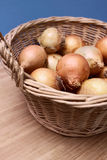 Basket with onions Royalty Free Stock Images