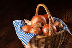 Basket with onions Royalty Free Stock Image