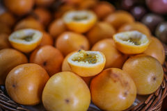 Basket of orange Passion fruit Stock Images