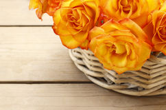 Basket of orange roses Stock Photography