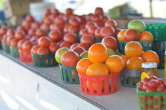 Basket Of Orange Tomatoes. For sale at a roadside fruit and vegetable stand royalty free stock photos