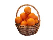 Basket of oranges. Basket of fresh oranges isolated on white with cutting path royalty free stock image