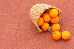 Basket of oranges on red background.  Stock Images