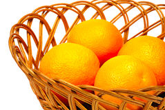 Basket of oranges on white Royalty Free Stock Image