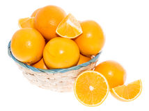 Basket with Oranges on white Royalty Free Stock Photography