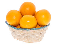 Basket with Oranges on white Royalty Free Stock Image