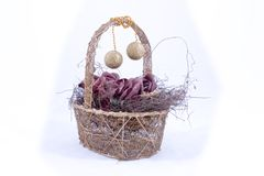 Basket with ornament decor. Wooden basket with ornaments hanging from handle Stock Photo