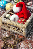 Basket with ornaments on the Christmas tree Royalty Free Stock Images