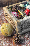 Basket with ornaments on the Christmas tree Royalty Free Stock Photography