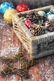 Basket with ornaments on the Christmas tree Stock Photography