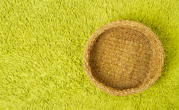 Basket over green carpet background Royalty Free Stock Images