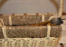 Basket and paintbrushes Stock Image