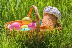Basket with painted eggs and Easter cake Stock Images