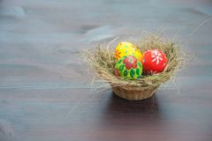 Basket with painted eggs Stock Photos