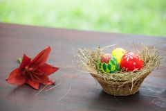 Basket with painted eggs Stock Photo