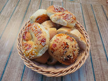 Basket with pastries. On the table is a basket, which is laid out in the form of various pastries and bread rolls Royalty Free Stock Photo