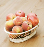 Basket with peaches and apples Stock Photos