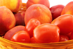 Basket of peaches and tomatoes close-up Royalty Free Stock Image